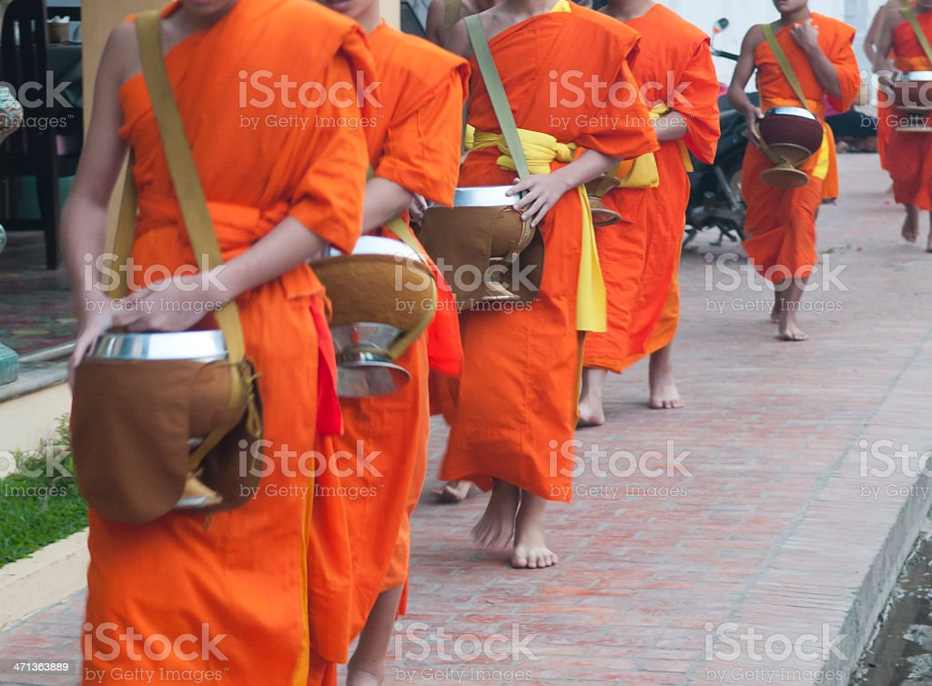 Monks with Alms Bowls stock photo