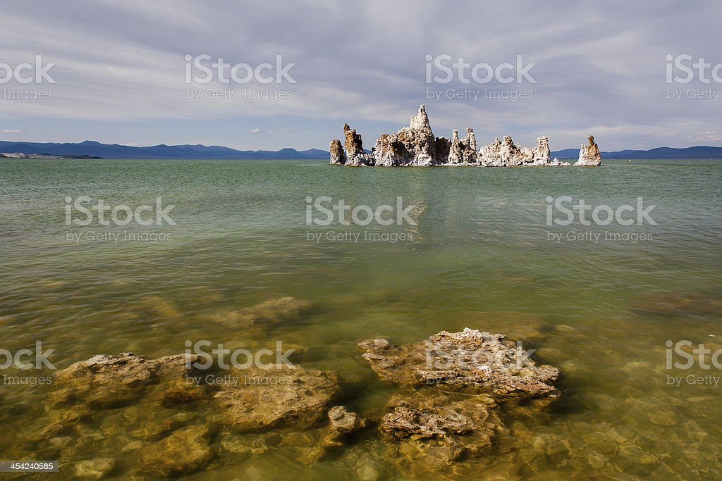Mono Lake tufa rock in green water royalty-free stock photo