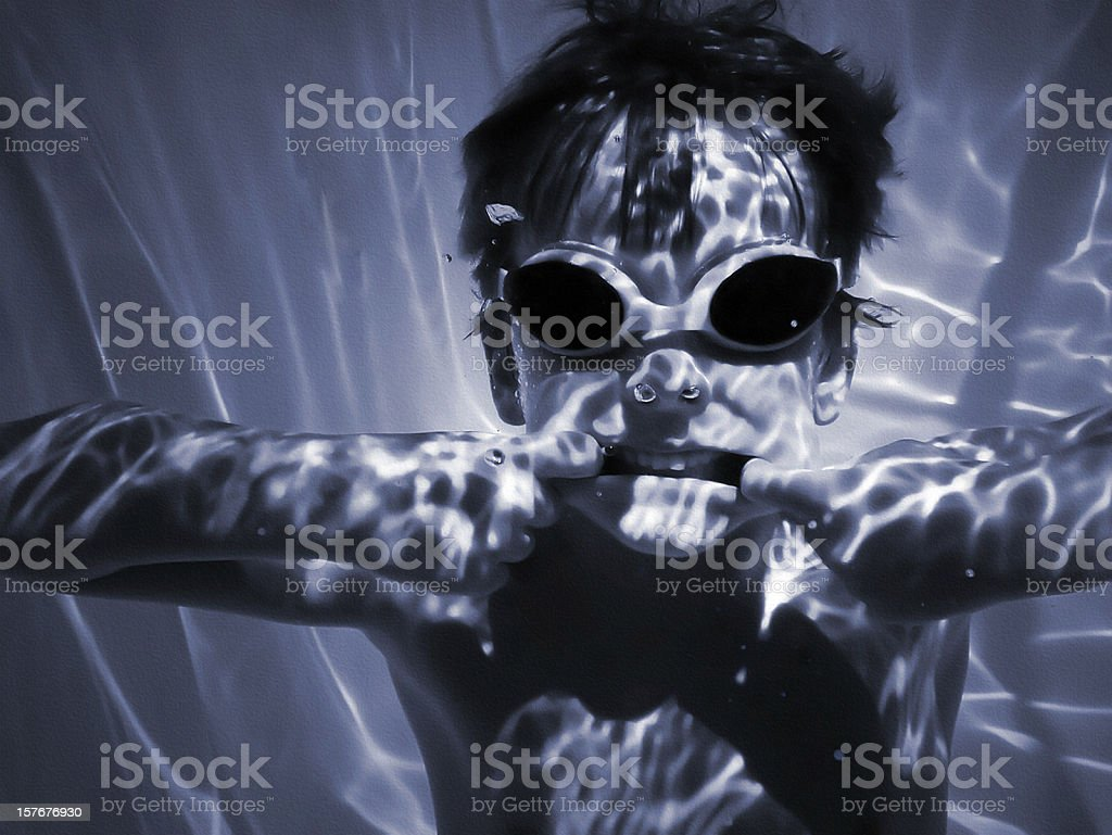 Monochromatic Boy Underwater Wearing Dark Goggles Making Face with Attitude royalty-free stock photo