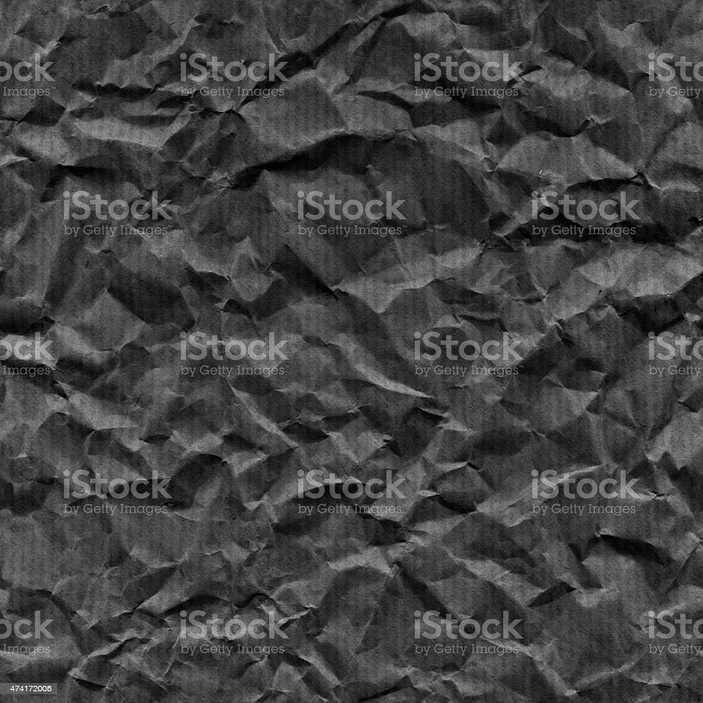 Monochromatic dark crumpled background wrapping paper stock photo