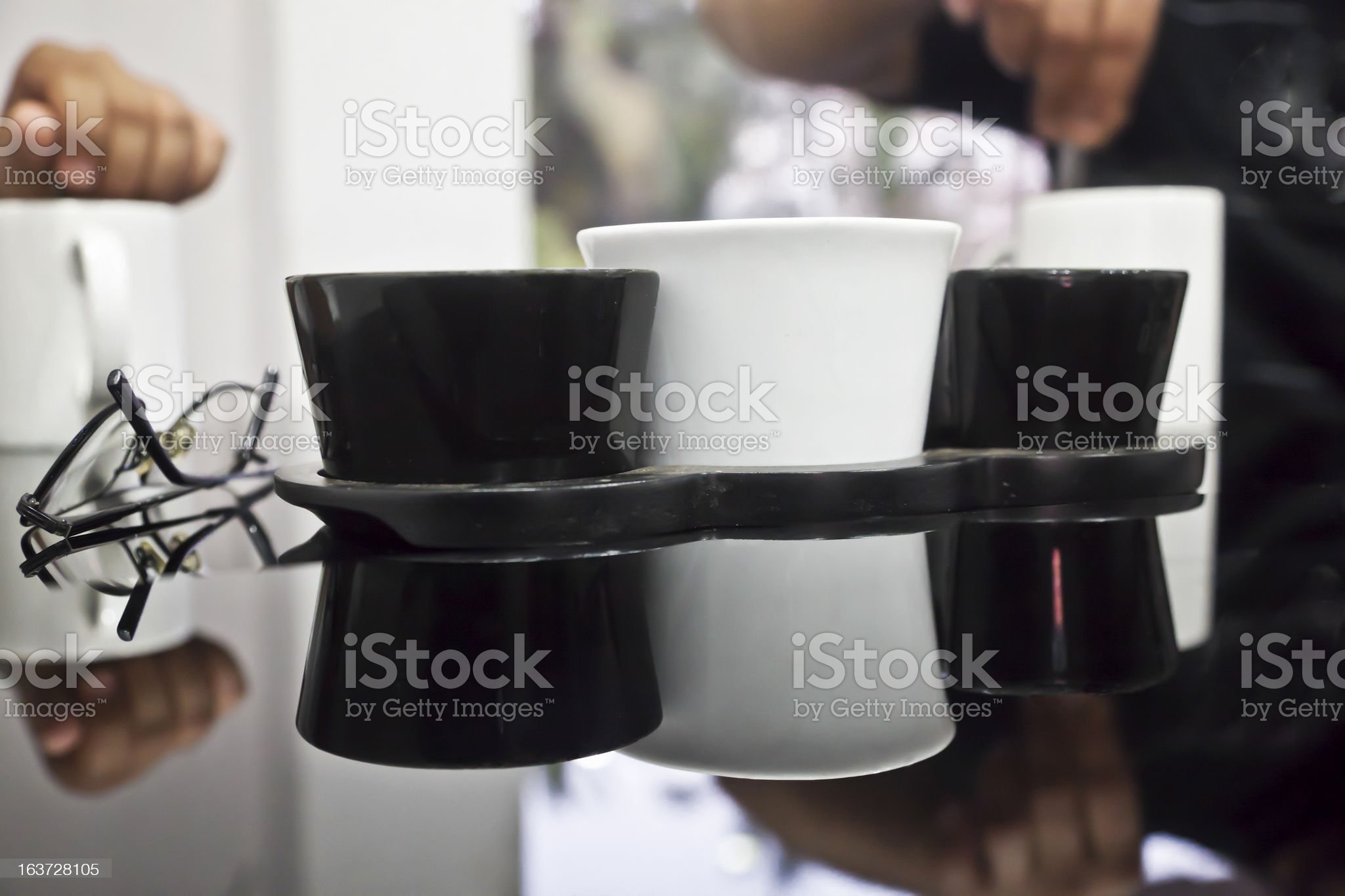 monochrome coffee table utensils reflections asian hands royalty-free stock photo
