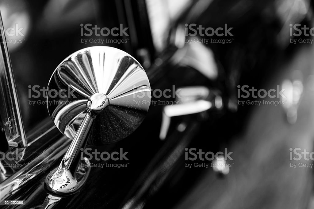 Monochrome detail of classic car mirror stock photo
