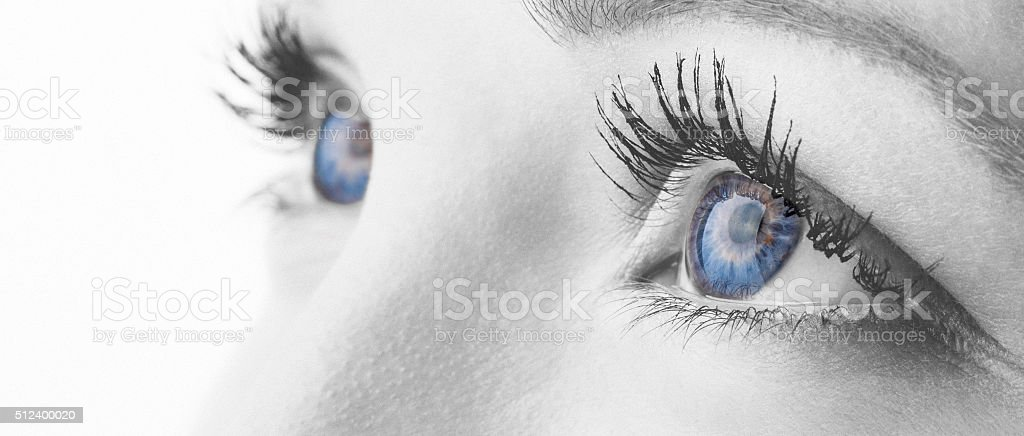 Monochrome edit macro shot of human blue eyes stock photo