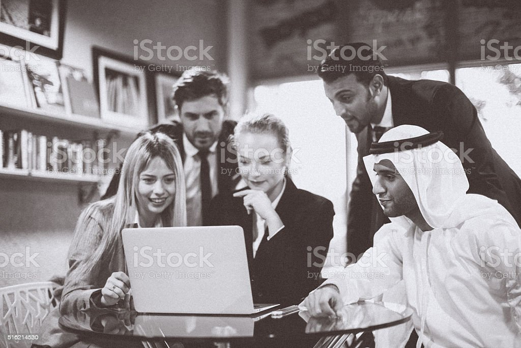 Monochrome of Discussion on a laptop between multicultural business professional stock photo