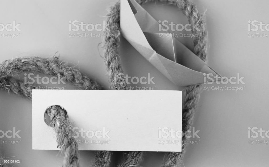 monochrome photo sticker with thick braided rope and ship paper stock photo