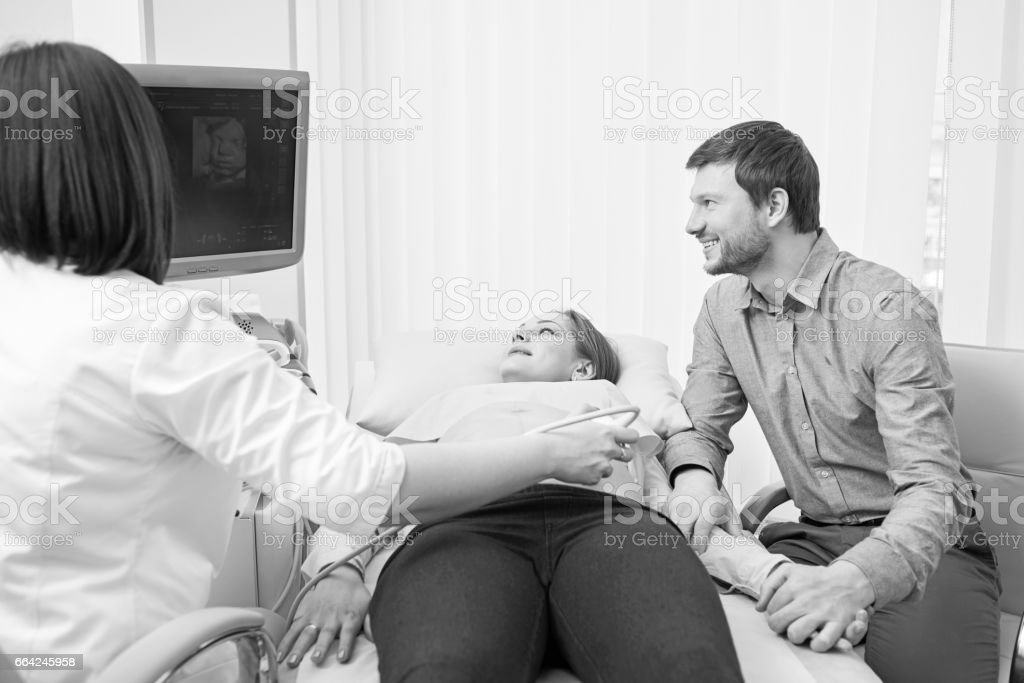 Monochrome shot of a loving pregnant couple at the hospital stock photo