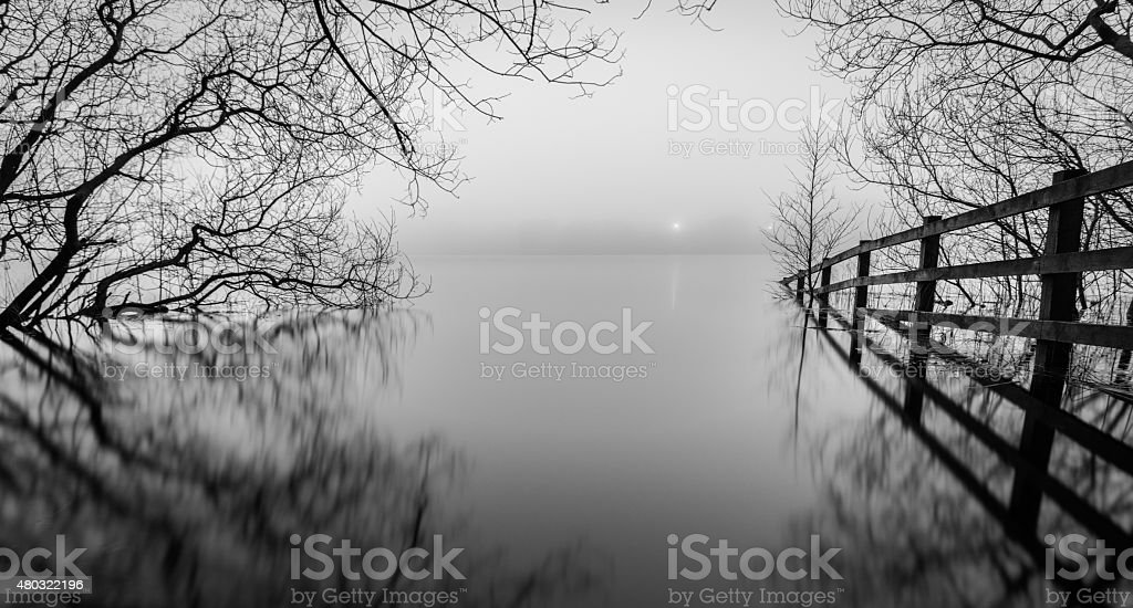 Monochrome View Of A Misty Lake. stock photo