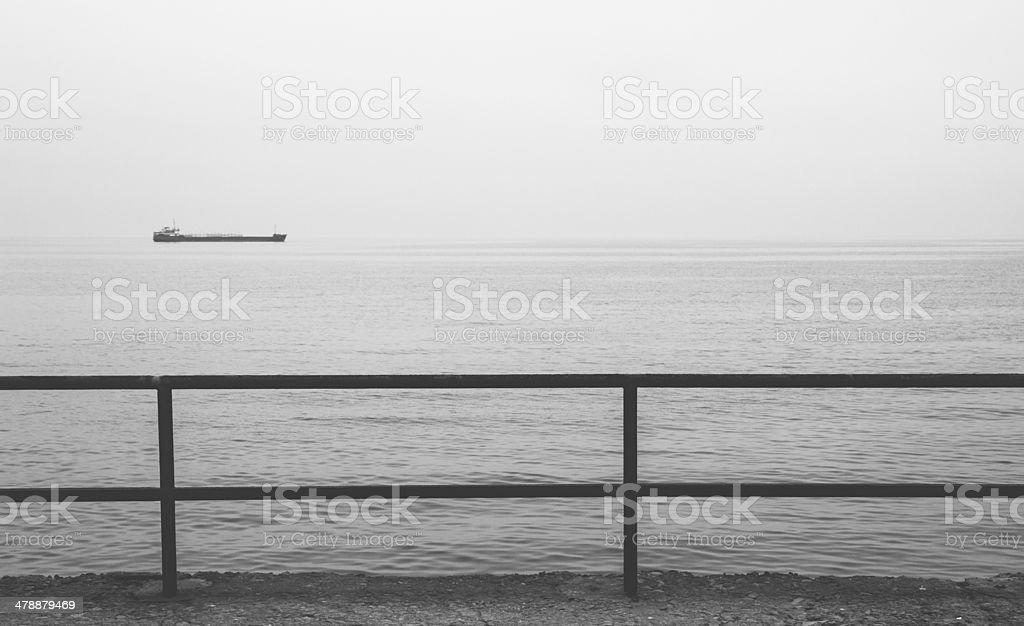 Monochrome view of industrial ship in the Black sea, Crimea stock photo