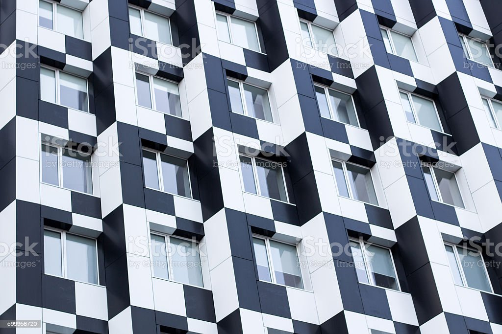 Monochromic cubic minimalistic bauhaus office building facade of business center stock photo