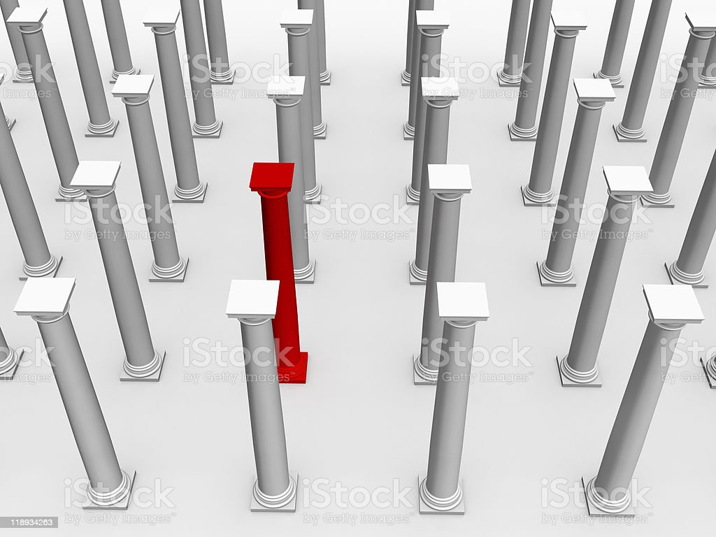monochromic image of classic columns. One is red royalty-free stock photo