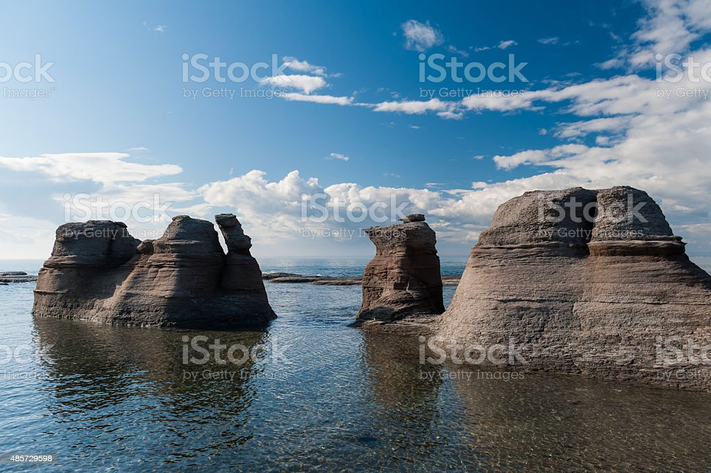 Monoliths under a beautiful blue sky  in  Mingan stock photo