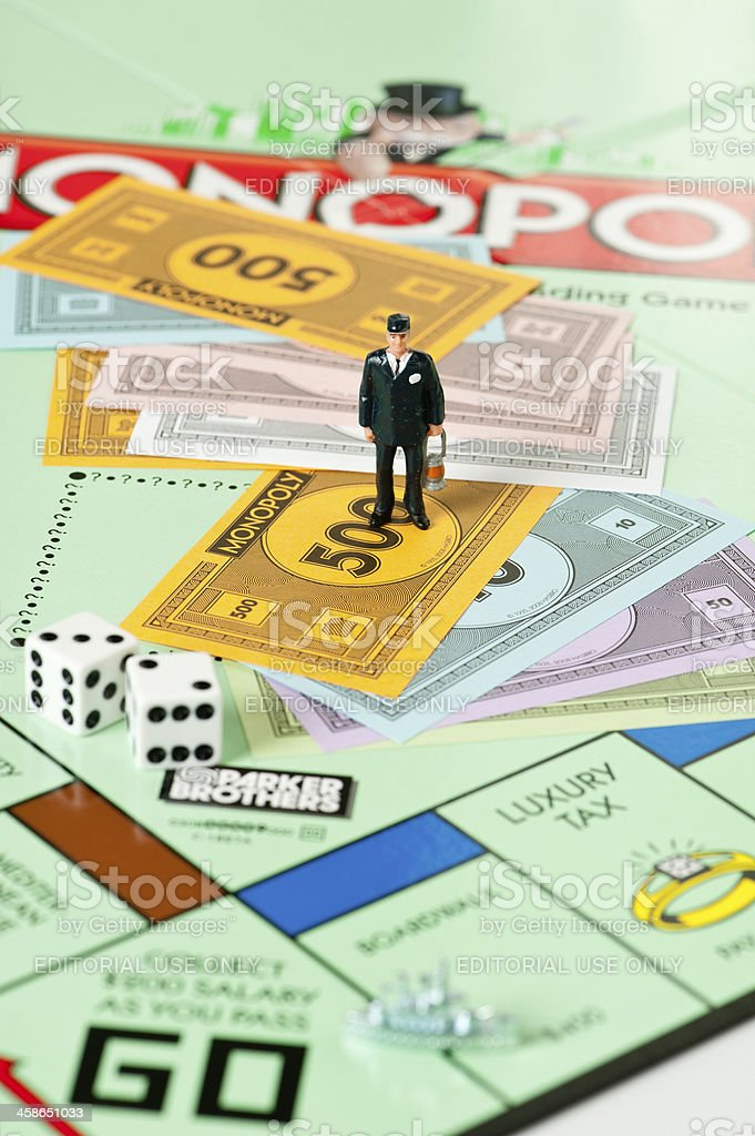 Monopoly Board Game and Financial Observer royalty-free stock photo