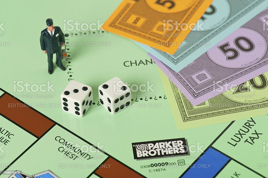 Monopoly Board Game and Financial Observer stock photo