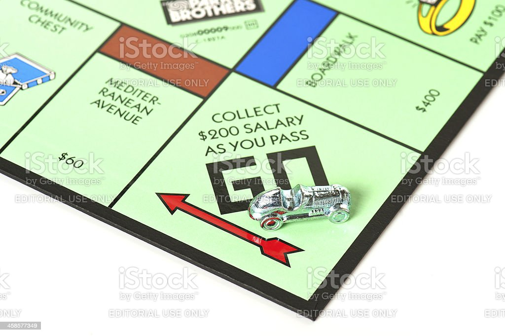 Monopoly Board Game Focused on Go Field and Car royalty-free stock photo