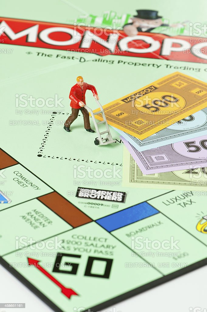 Monopoly Board Game, Manual Worker, Dolly and Money royalty-free stock photo