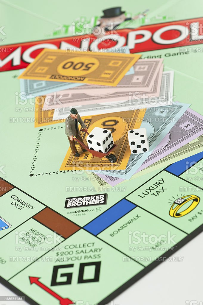 Monopoly Board Game, Manual Worker, Wheelbarrow and Money stock photo