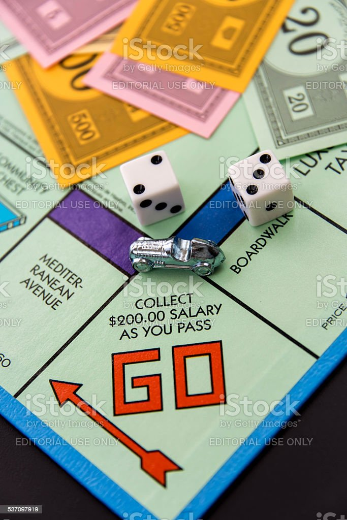 Monopoly - car on Go square stock photo