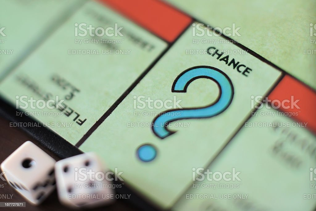 Monopoly Chance - Question mark, concept stock photo
