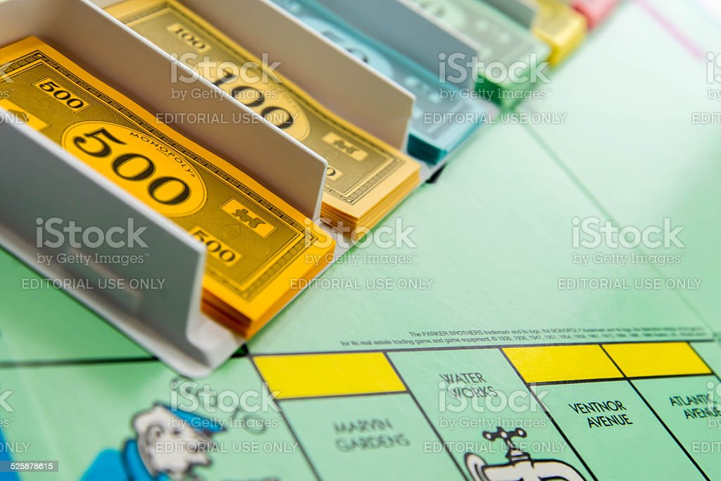 Monopoly - closeup of the bankers money and the board stock photo