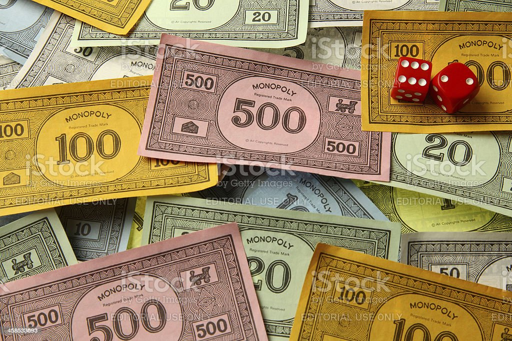 Monopoly game money with dice stock photo