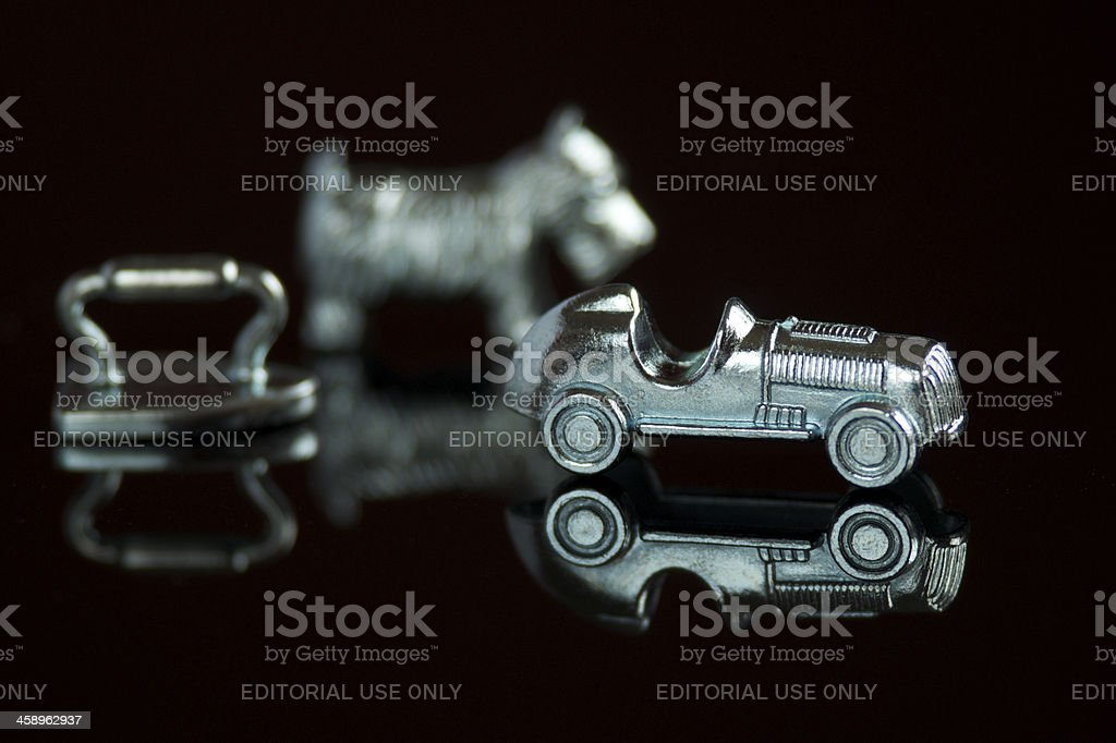 Monopoly game pieces stock photo