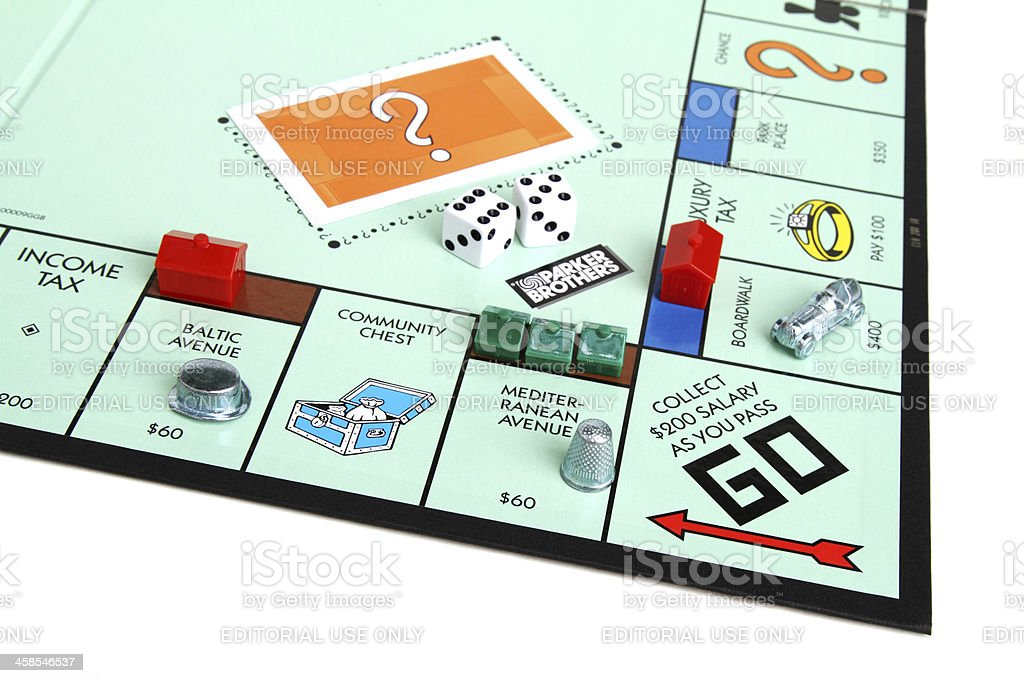 Monopoly game with Go square and pieces stock photo