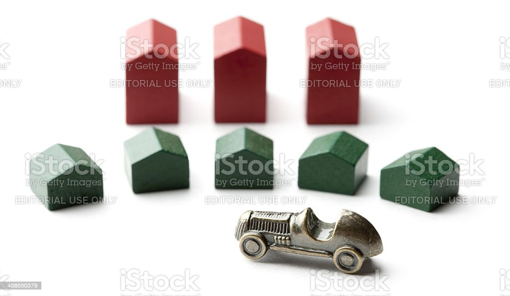 Monopoly Hotels and Houses with Car Token stock photo