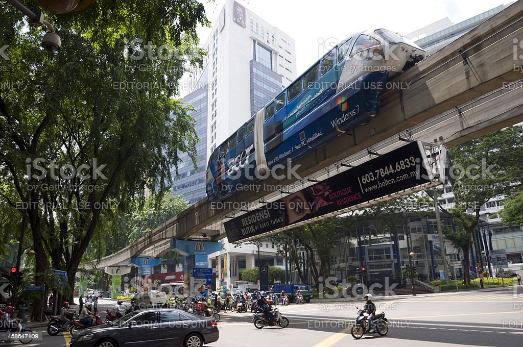 Monorail train passing a busy crossroad stock photo