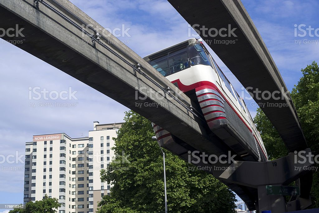 Monorail Transit Train Travels Over Neighborhood Carrying People Downtown stock photo