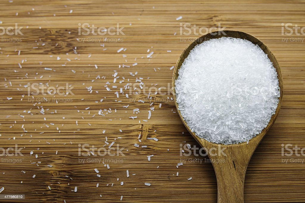 Monosodium glutamate (MSG) in wood spoon stock photo