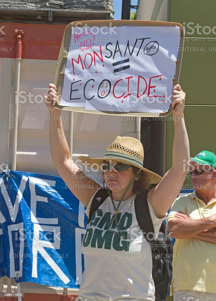 Monsanto Equals Ecocide GMO Protest Sign stock photo