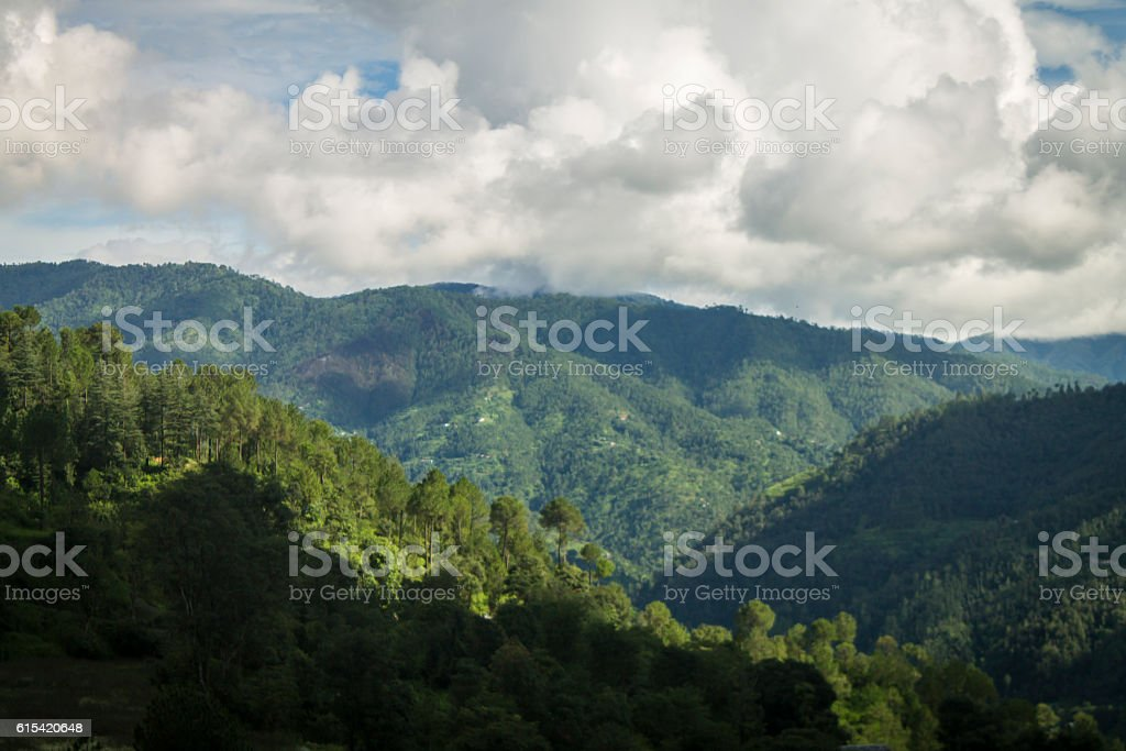 Monsoon clouds over mountains stock photo