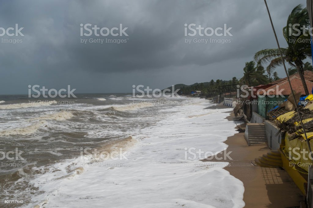 Monsoon Goa, Anjuna beach with high water stock photo
