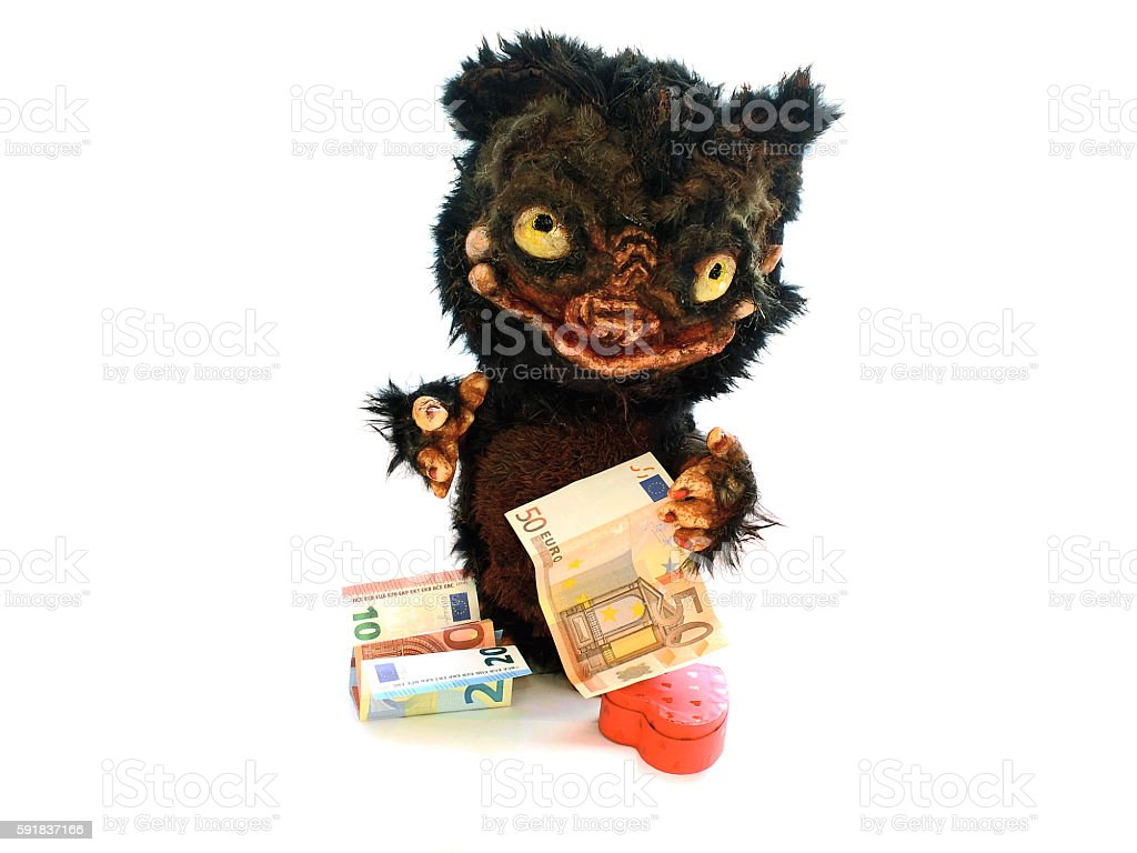 Monster doll souvenir with Euro money bills and heart stock photo