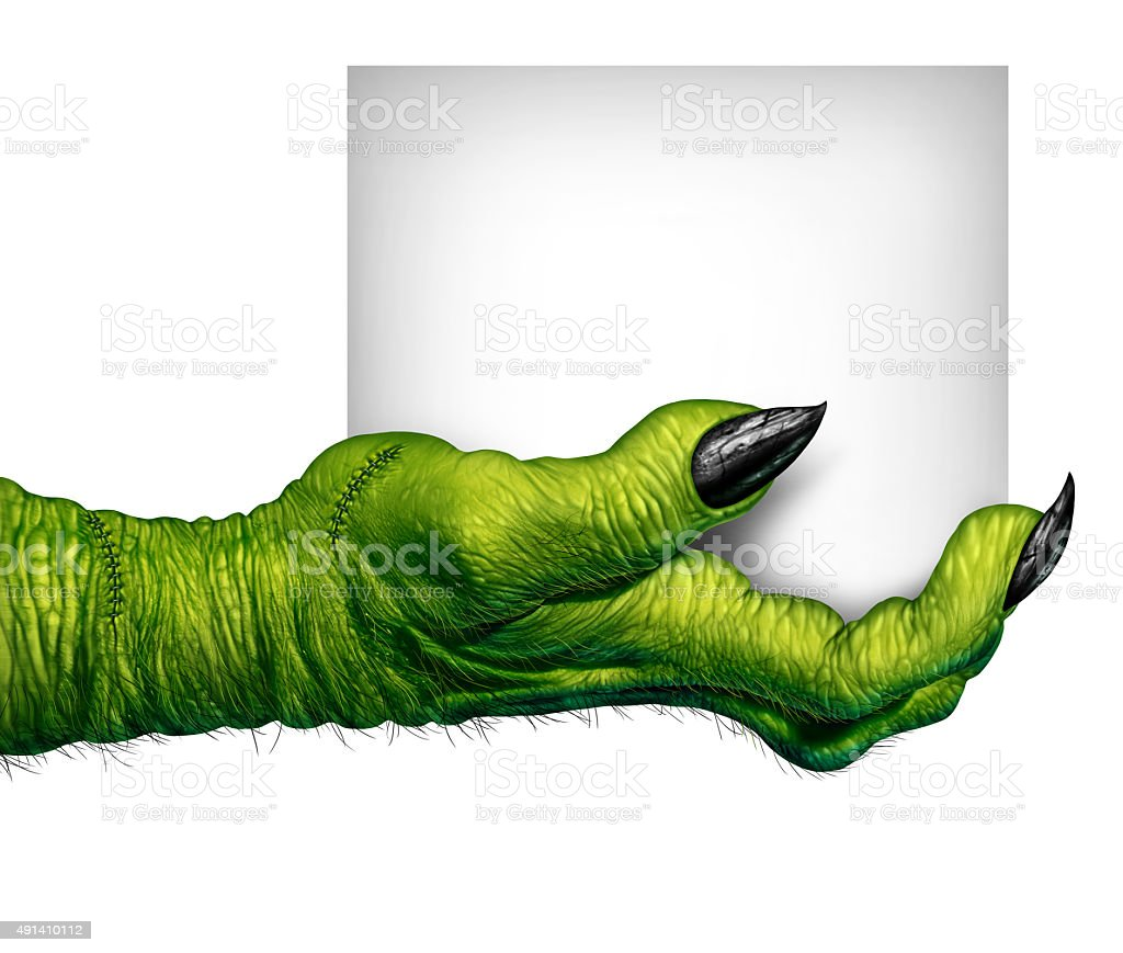 Monster Hand Holding Sign stock photo