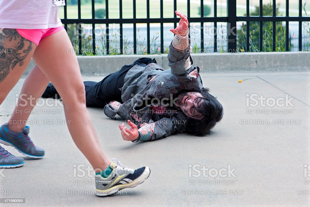 Monster Reaches For Women Passing By In Atlanta Zombie Run stock photo