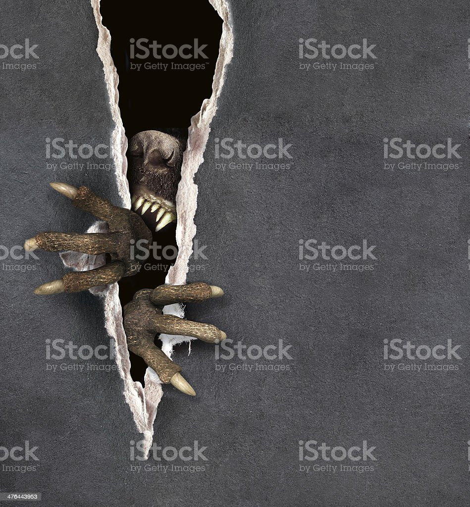 Monster tearing a paper stock photo