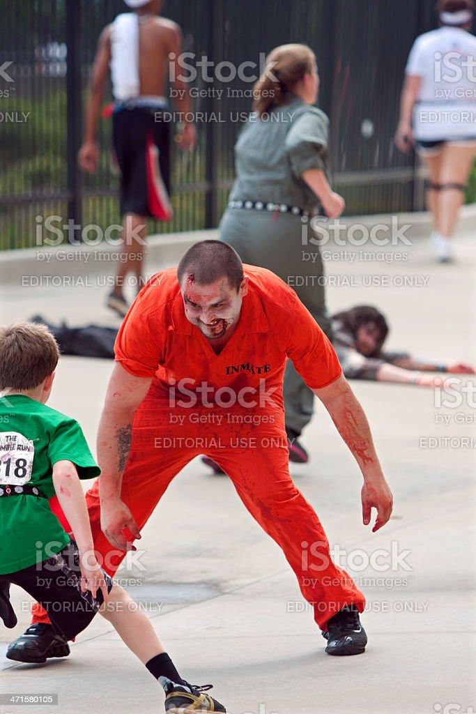Monster Tries To Catch Kid Running In Atlanta Zombie Run stock photo