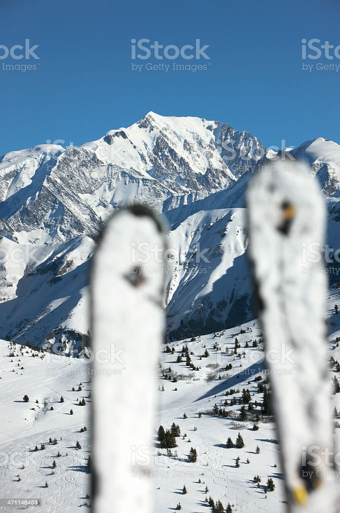 Mont Blanc, Europe's highest mountain, viewed through snow covered skis. royalty-free stock photo