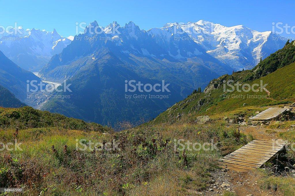 Mont Blanc idyllic alpine landscape – bridge path – Chamonix Alps stock photo