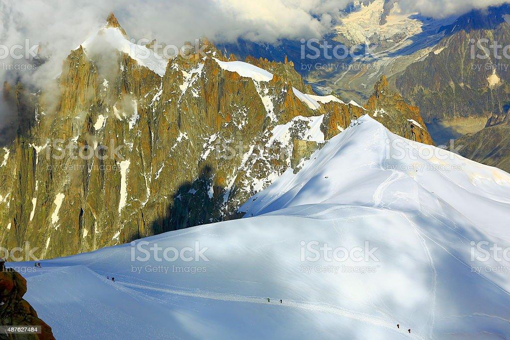 Mont Blanc impressive alpine landscape and tiny climbers stock photo