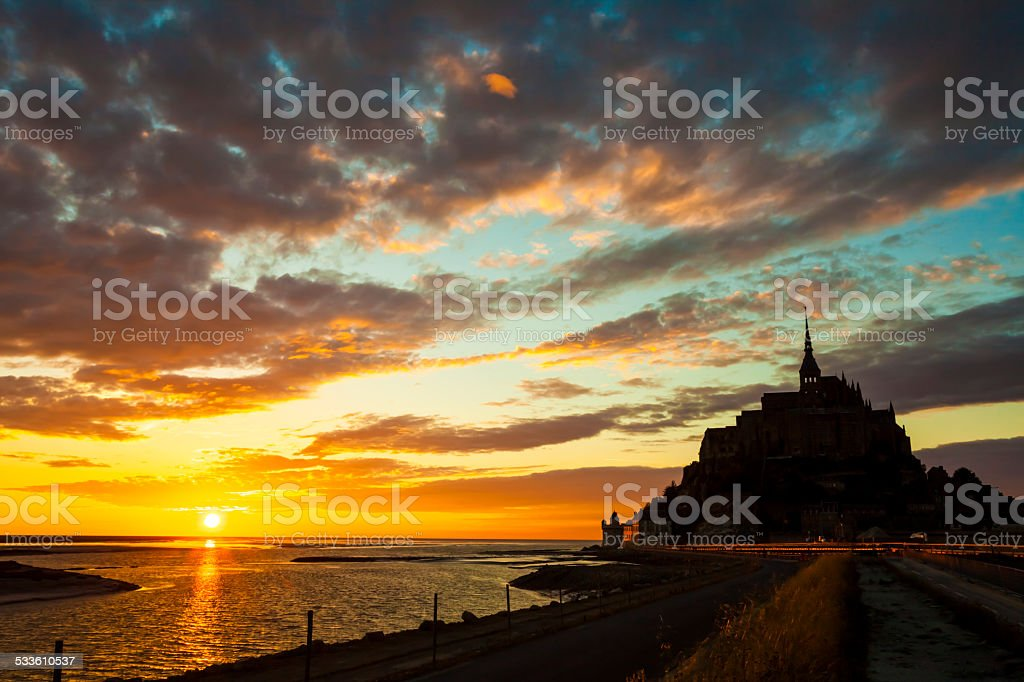 Mont Saint Michel in sunset light stock photo