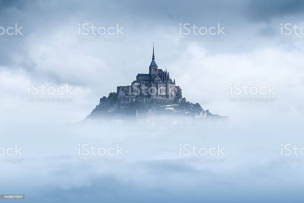Mont Saint Michel in the mist stock photo