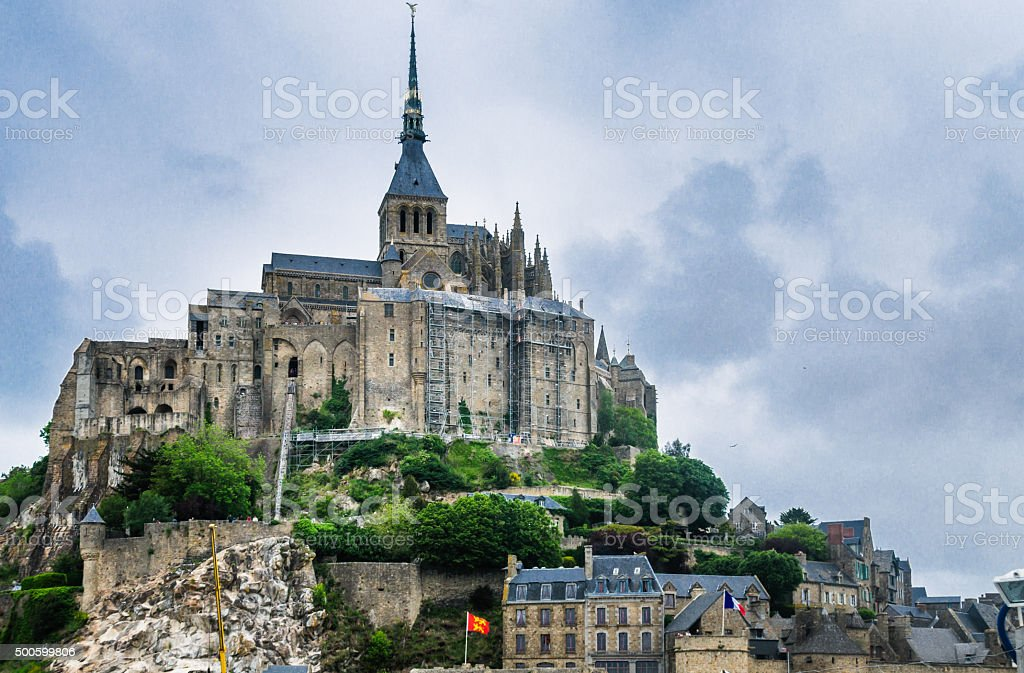 Mont Saint-Michel under overcast sky stock photo