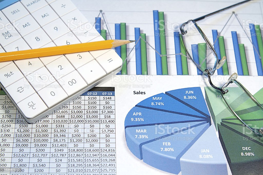 Montage of colored business charts with glasses, calculator royalty-free stock photo
