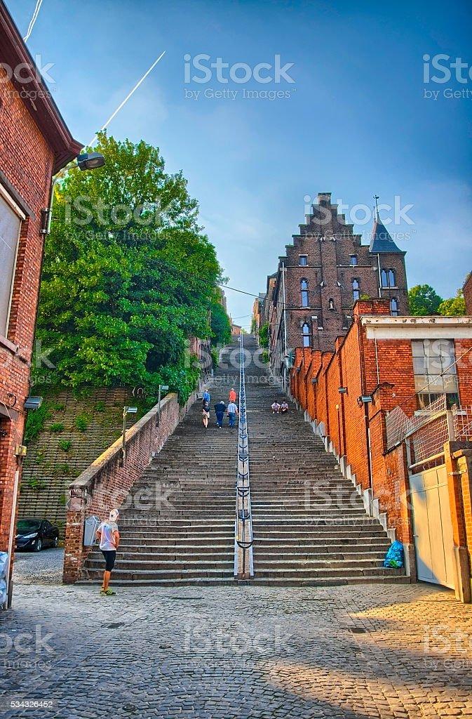 Montagne de beuren stairway with red brick houses in Liege stock photo
