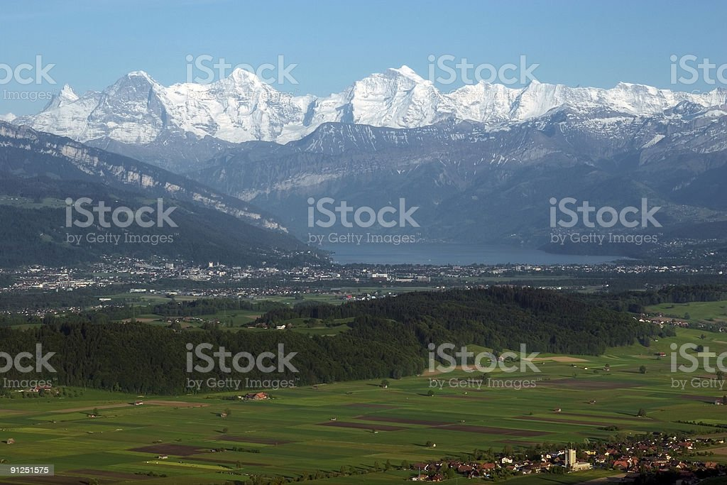 Montains over Lake Thun in Switzerland. stock photo