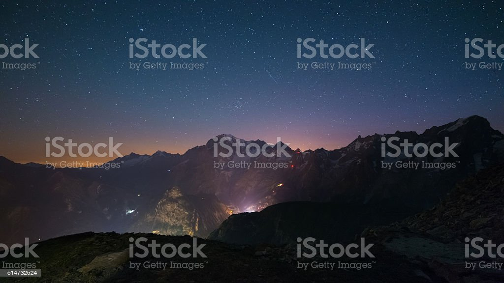 Monte Bianco (Mont Blanc) nightscape with starry sky stock photo