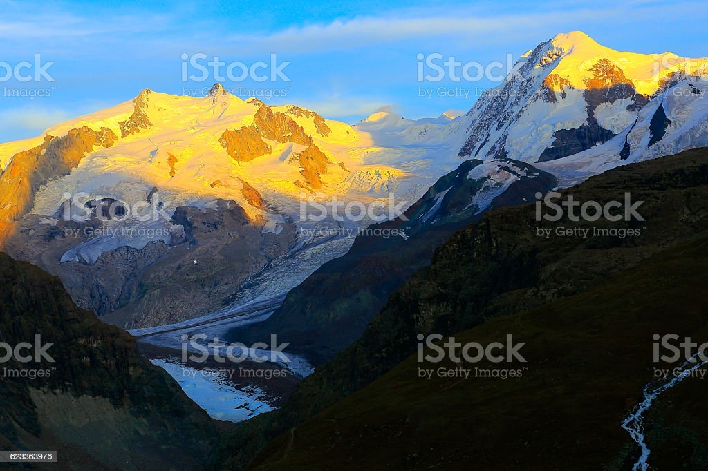 Monte Rosa and Breithorn above Gorner glacier sunset, Swiss Alps stock photo