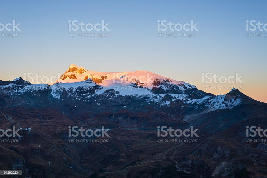 Monte Rosa glaciers glowing at sunset, italian side stock photo